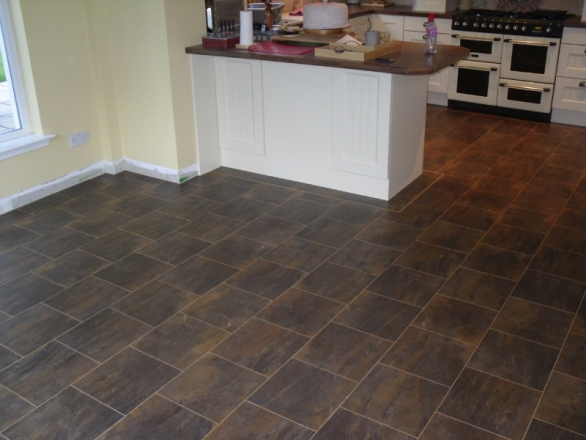 Imperfect Subfloor transformed by a  Perfect Karndean Floor